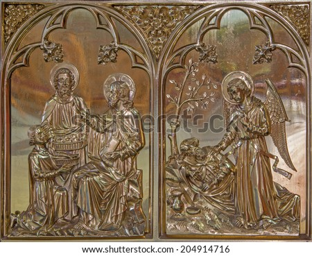 BRUGGE, BELGIUM - JUNE 13, 2014: The Miracle Miracle of Multiplying Food and the Angel give the bread to prophet Elijah scene. Neogothic metal relief in st. Giles (Sint Gilliskerk).  - stock photo