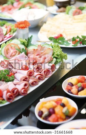 Brunch Buffet with ham, cheese and fruit - stock photo