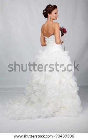 Brunet bride portrait in studio - stock photo