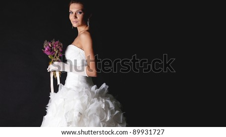 Brunet bride portrait in studio isolated on black