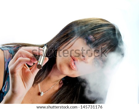 brunette beautiful girl smoking electronic cigarette - stock photo