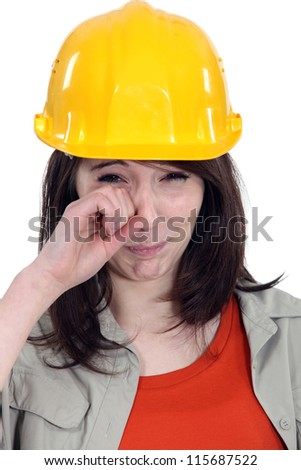 Brunette builder crying - stock photo
