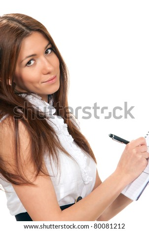 Brunette Business woman standing thinking and looking at the camera and writing with pen in the hand notebook organizer paper in casual dress on a white background - stock photo