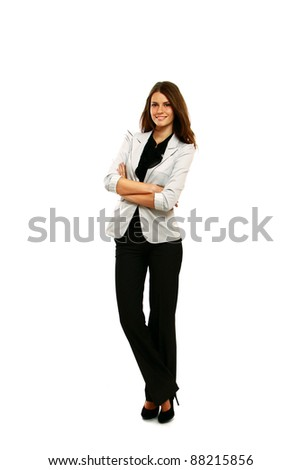 Brunette businesswoman with folded arms isolated - stock photo