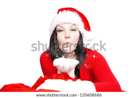 brunette christmas woman blowing stars dust over white background - stock photo