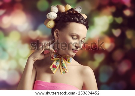 Brunette, colorful, spring, pretty woman with funny outfit and egg hairstyle. She has got loop on her neck. - stock photo