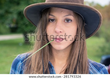 Brunette cowgirl posing on farm  - stock photo