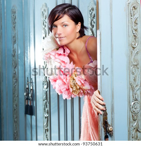 brunette fashion woman retro vintage in wardrobe and spring pink flowers dress