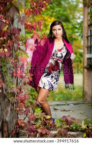 Brunette girl at overgrown house. - stock photo