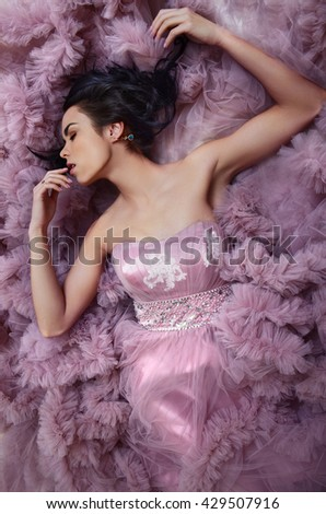 Brunette girl beautiful violet dress