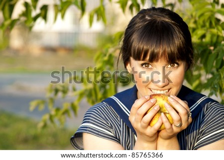 Brunette girl eating an apple