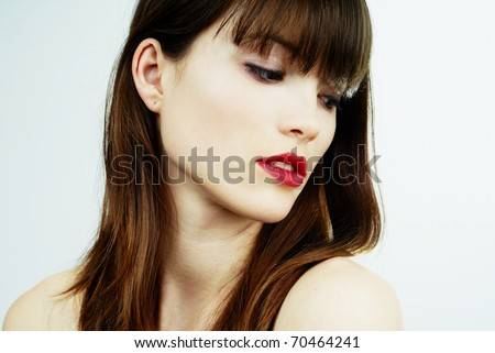 brunette girl - face close-up - stock photo