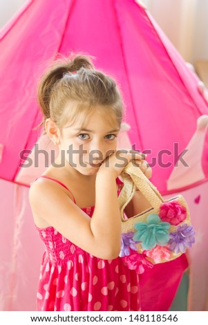 Brunette girl holding fashion spring flowers bag - stock photo