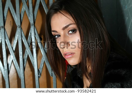 Brunette girl posing in elevator - stock photo
