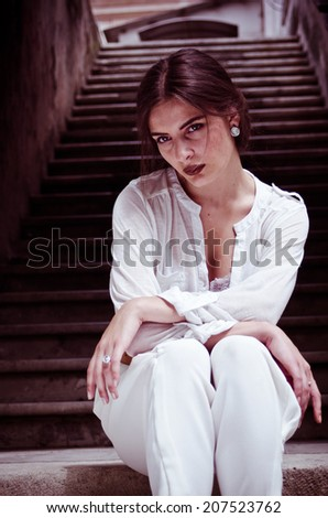 brunette girl sitting on the stairs