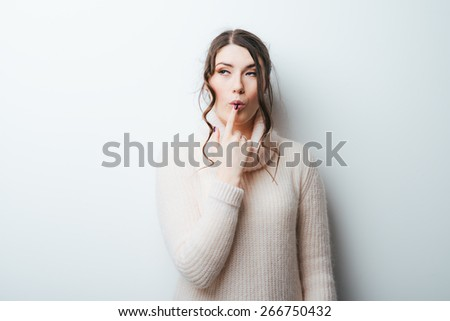 brunette girl thought for a white background - stock photo