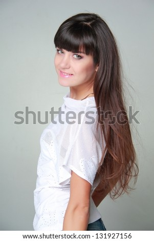 brunette girl wearing white sexy blouse