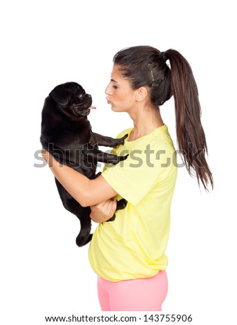 Brunette girl with her pug dog on yellow background - stock photo