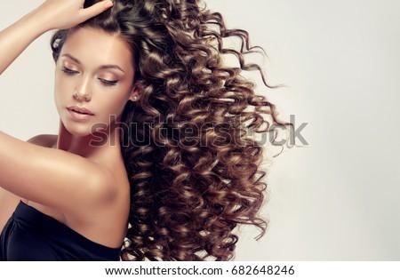 Curly haired brunnett milf