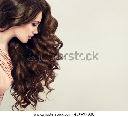 brunette girl long shiny wavy hair stock photo