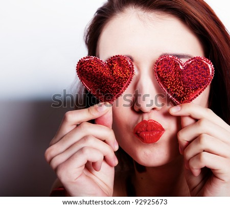Brunette girl with red hearts isolated on white - stock photo