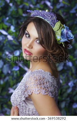 Brunette girl with the coronet from flowers, portrait shot - stock photo