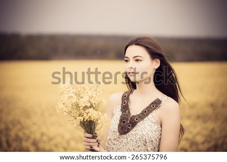 brunette girl with yellow bouquet - stock photo