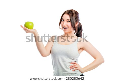 brunette holding a green apple in the palm of your hand - stock photo