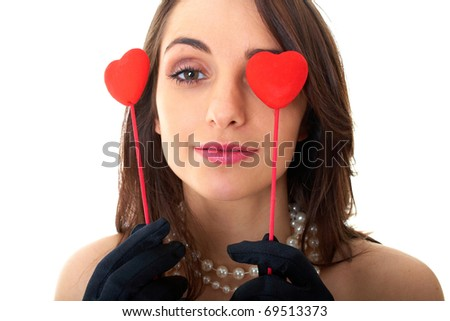 brunette in red dress holds two hearts, isolated on white background - stock photo