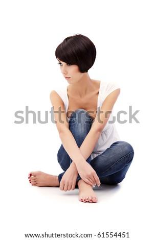 Brunette lady with blue eyes sitting on white background - stock photo