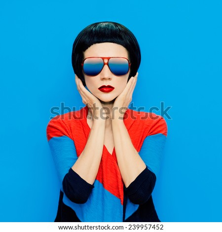 Brunette Lady with fashion Haircut and Sunglasses on blue background - stock photo