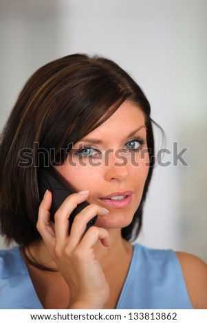 Brunette listening attentively to phone call