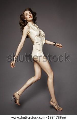 Brunette model posing in studio - stock photo