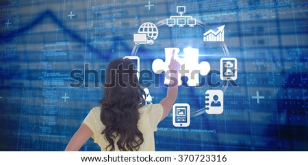 Brunette pointing in rear view against blue data - stock photo