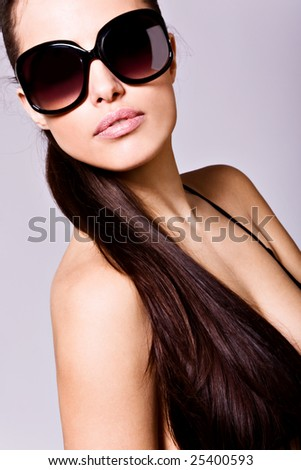 brunette portrait with sunglasses - stock photo