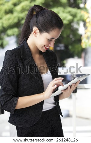 Brunette secretary in dark suit out from the office - stock photo