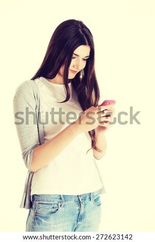 Brunette teen texting to someone - stock photo