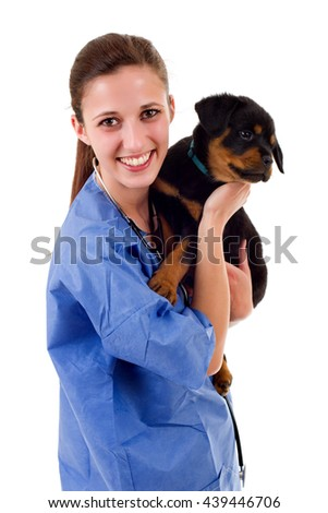 Brunette veterinary with a rottweiler puppy dog isolated on white background - stock photo