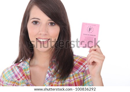 Brunette with a driving license - stock photo