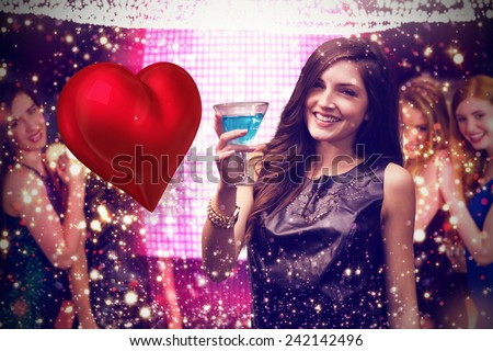 Brunette with cocktail against red heart - stock photo