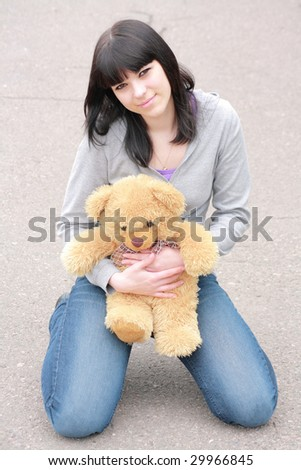brunette with plush teddy bear