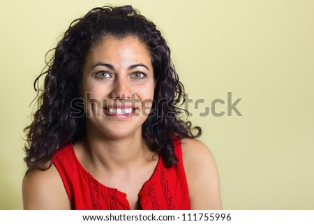 Brunette woman in a yellow background - stock photo