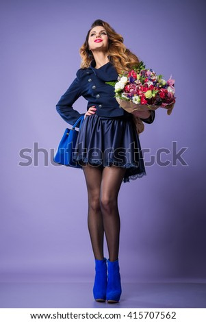 brunette woman in high heels on a purple background with flowers and handbag