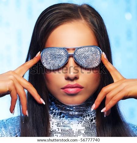 Brunette woman in stylish sunglasses - stock photo