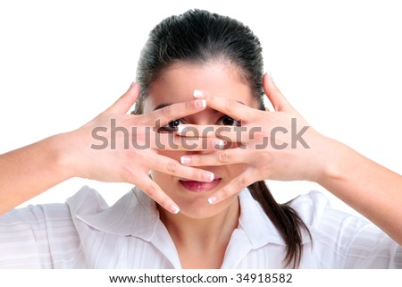 Brunette woman looking through her fingers, isolated on a white background. - stock photo