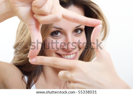 brunette woman making a frame by her hands - stock photo