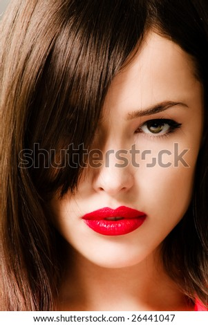 brunette woman portrait with red lips - stock photo