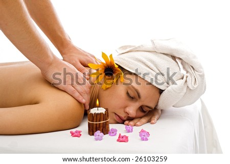 Brunette woman relaxing and getting back massage - stock photo