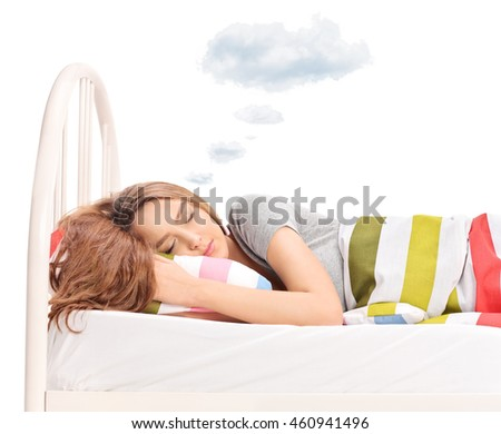Brunette woman sleeping on a bed and dreaming with a cloud above her head isolated on white background