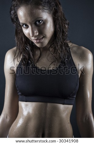 brunette woman smiling after workout . wet hair - stock photo